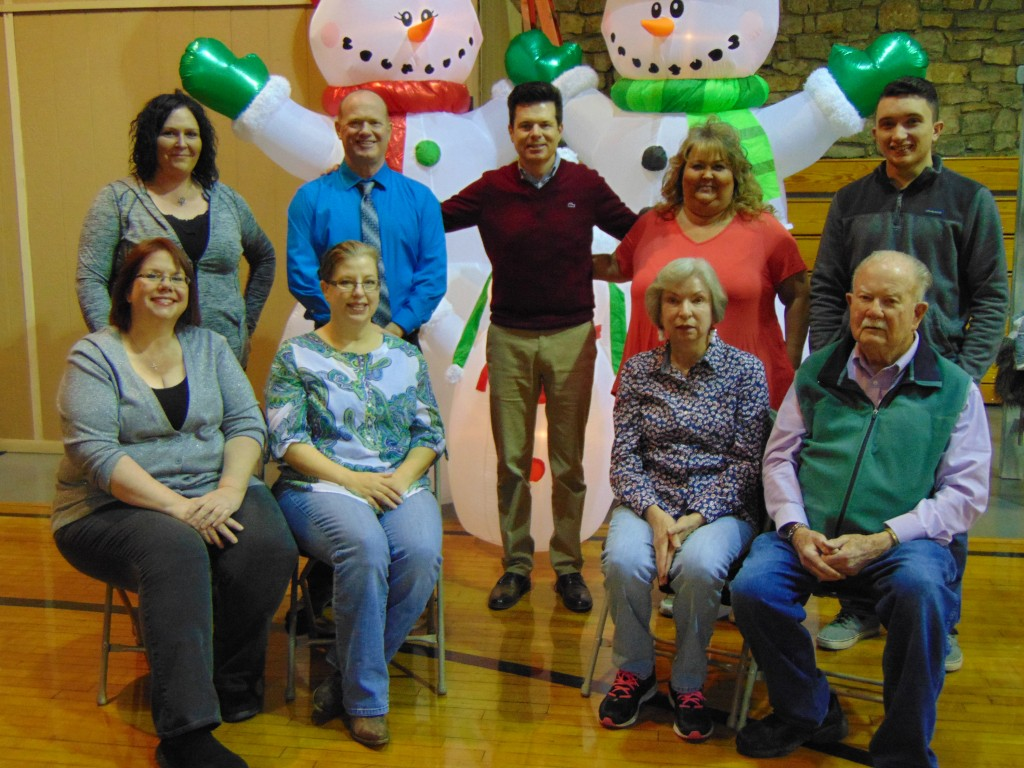 HAPPY NEW YEAR FROM THE STAFF OF THE BENTON COUNTY ENTERPRISE. We are front row left to right: Carrie Rieman, Lael Johnson, Judy Kramer and Homer May. Back row left to right: Rachael Sherrer, Mac Vorce, James Mahlon White, Kimberly Keeton and Tyler Douglas Simons. Unable to be present for the photo were Anita Campbell, Jo White, Joyce Coates, Johnie Logue, Buffy Vorce And Tabitha Mounkes.