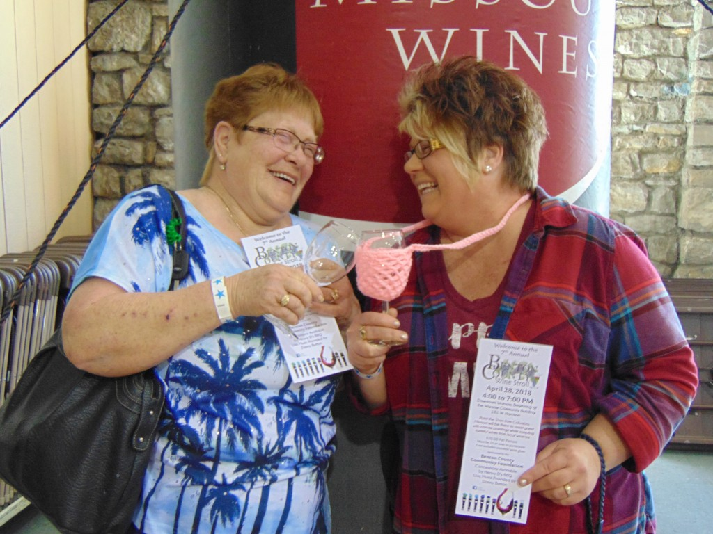 READY TO SIP, SHOP AND STROLL, Claudine Nevius and Tammy Burnworth took part in Saturday's Benton County Community Foundation Wine Stroll on Warsaw's Main Street.