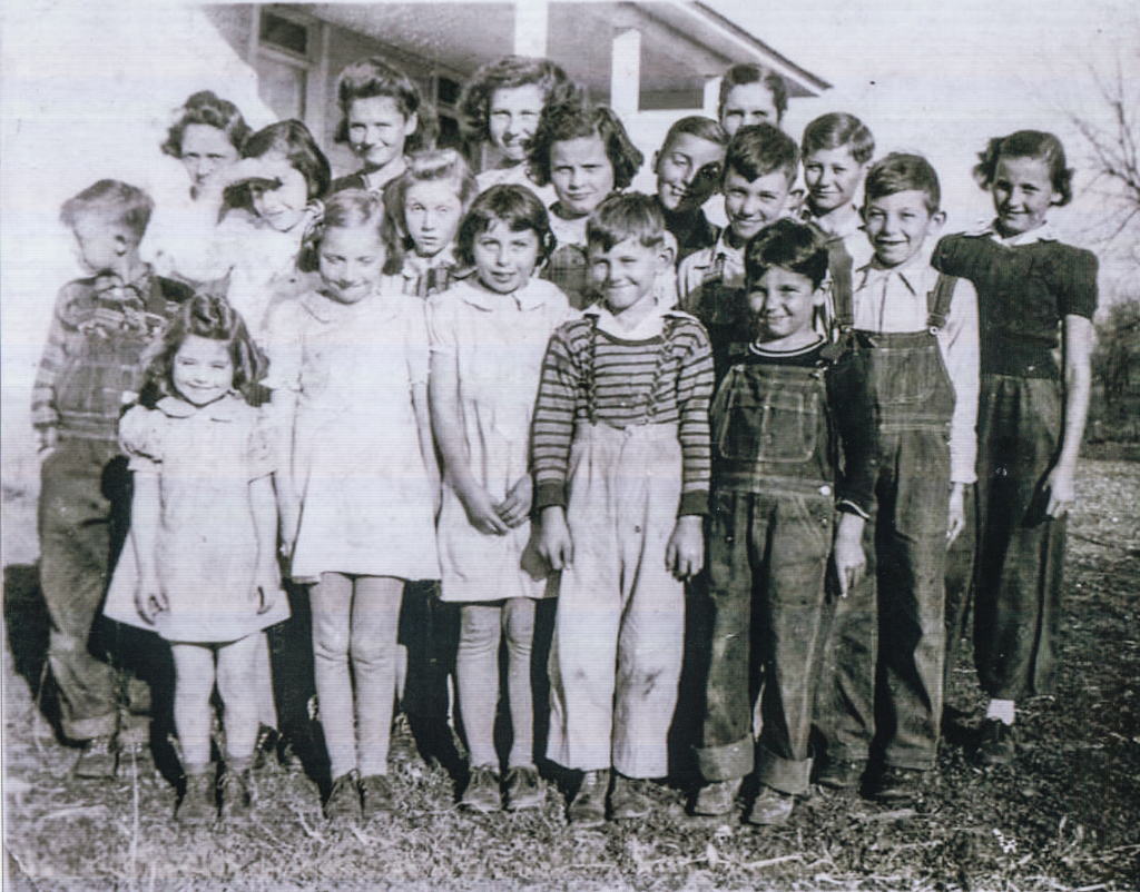 WALNUT GROVE SCHOOL 1943-1944 Front Row: Nadine Motley, Helen Massey, Mike Robb, Murl Leeders, Jr. Middle Row: Midde Row, Kenneth Motley, Beth Beyer, Helen Beyer, Elaine Breasher, Bill Hutton, Lew Massey. Back Row: Charlotte Robb, Helen Sledd, Bonnie Sue Rob, Homer Sledd, Geneviene Drake (teacher), Gene Farr, Donna Robb.