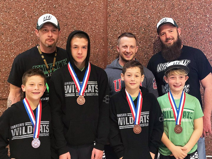 WARSAW WILDCAT YOUTH WRESTLING is State Bound. They will go to battle Friday, March 30 at the Chaifetz Arena in St. Louis. Pictured are back row, right to left: Coaches J.D. Wilson, Brian Phillips and Joey Muldoon.<br />Front row, right to left: Bostyn Wilson 8U- 90 lbs., Hunter Dority 14U- 120 lbs, John Wilson II 10U- 90 lbs., and Urijah Phillips 10U- 95 lbs.