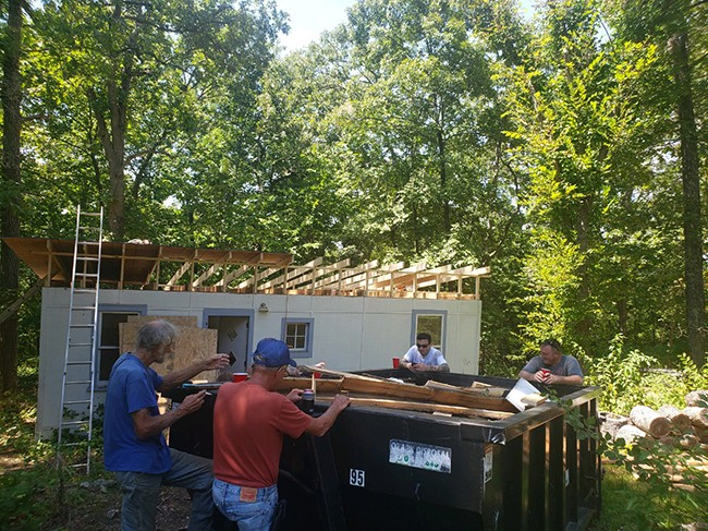 RALLYING to make their community a better place, Don Draeger, Mike Duensing, Aaron Shadd and Jim Cummings worked on one of several new projects at Arrowhead Lake Estates in Edwards.