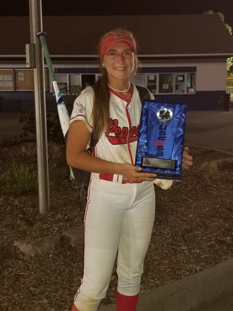 WHS SENIOR AUBRIE MCROBERTS HOLDS the National Championship Trophy,that her team, the Peppers, won recently. She was named the Offensive MVP batting .531.