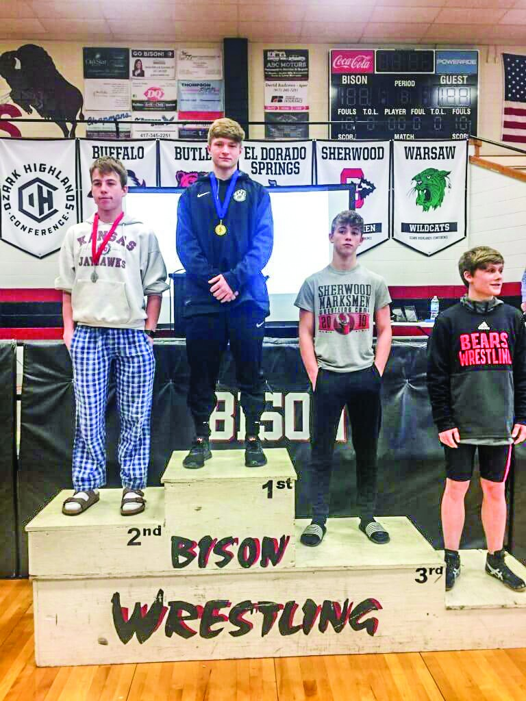 STANDING ATOP THE PODIUM, Warsaw sophomore Nick Bagley claimed an Ozark Highlands Conference championship in the 132 pound weight class at Saturday's tournament. Bagley is now 17-6 in his 2020-21 season.