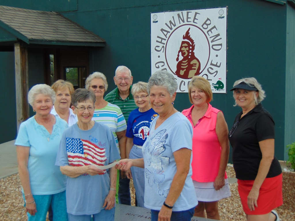 SWINGING FOR A CURE, the Shawnee Bend Ladies Golf League presented officials from the Benton County Cancer Fund with a check last Tuesday.  Attending the ceremony were front row June Walthall and Flo Dwyer. Back row: Betty Patterson, Ruth Ann Karman, JoAnn Weinberg, Larry Walthall, Deb Hickman, Debbie Brockman and Kelly Stackhouse.