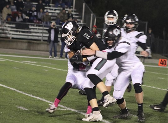 WARSAW'S GRAYSON GREGRICH FIGHTS FOR EXTRA YARDS in the Wildcats 66-64 double overtime victory over Skyline last Friday night.  Gregrich finished with 188 yards receiving and the Wildcats improved their season record to 6-3.  They'll face Stockton at home this week.