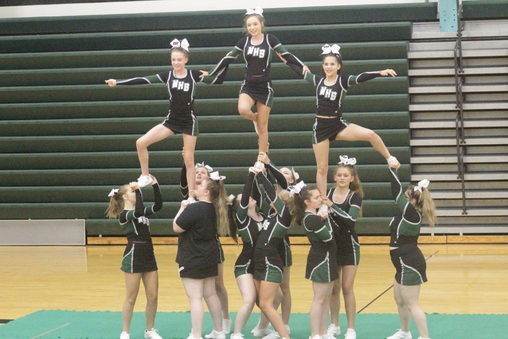 DON'T TRY THIS AT HOME. The Warsaw cheerleaders formed a pyramid last Week at WHS during cheer leading camp.