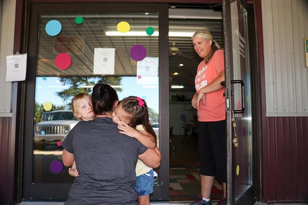 AREA CHILDCARE PROVIDERS have adjusted to a new normal in the age of COVID-19, with guidance from the Health Department. Sandy Turner gave a goodbye hug to her children Eli and Emily as Trish Krum welcomed them at Miss Rhonda's Daycare in Warsaw.