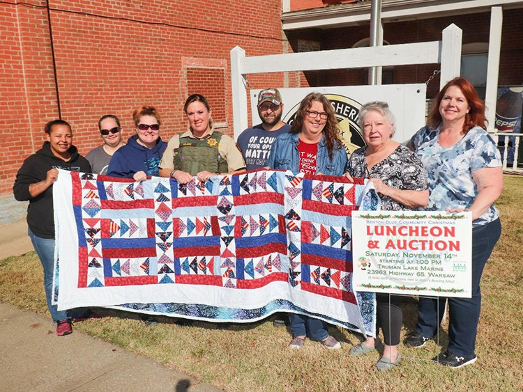 ON A MISSION to help area law enforcement this Christmas, volunteers are seeking donations. The program will benefit police and deputies in Benton County. Gathering to promote the event were Mariah Williams-Brueggeman, Sherry Ann Bayless, Millie Kauffman Prichard, Corporal Nikki Haake, Lawrence Bayless, Donna Goodwin, Mollie White and Carrie Rieman.