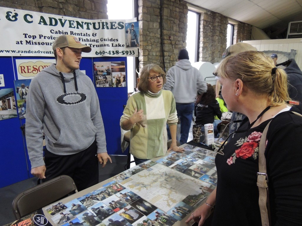 A JAM PACKED Warsaw Community was the scene on Saturday for the Hunting And Fishing Expo sponsored by the Warsaw Area Chamber of Commerce.  R &C Adventures was represented by Christine Letcher who spoke with attendees Brad Jelinek and TonyaThies.