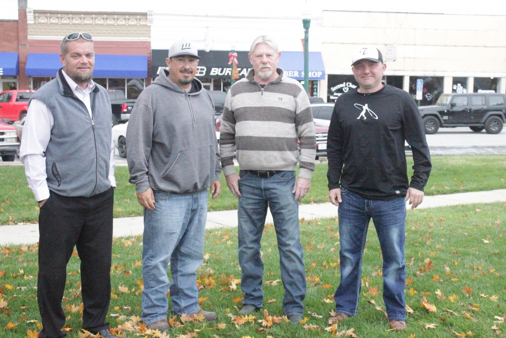 THE MEN BEHIND THE SCENES. Adam Howe, Eric Flores, Ron Strader and Shane Simons are the behind the scenes traveling team coaches of the girls who play softball for WHS. Their dedication and love of the game has been a major factor in the success of the softball program.