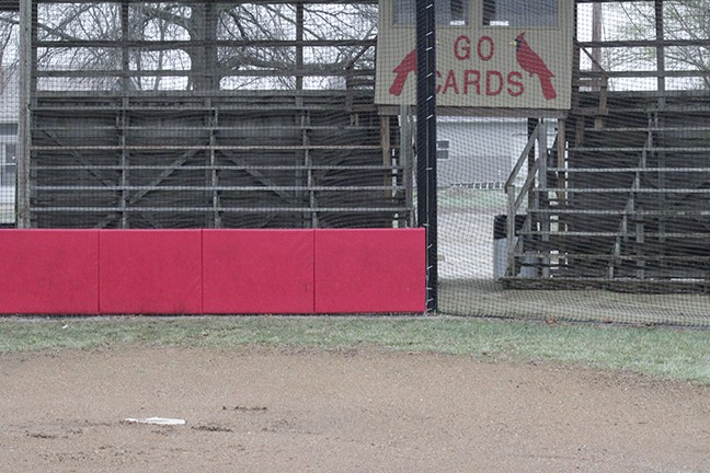 FROZEN GRASS AND A MUDDY LINCOLN CARDINAL'S BASEBALL FIELD lays barren on a dreary, misty Monday afternoon. A very wet ,cold and unpredictable Spring has called a halt to baseball, softball, golf and track events in Benton County and over most of Missouri. The 4-0 Lincoln Cardinals have finally found something they cannot defeat and that is simply the weather.