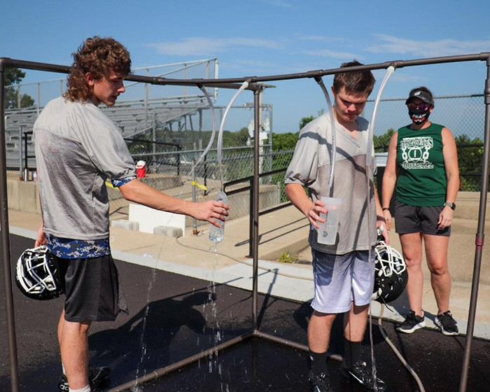 PROTOCOLS ARE IN PLACE to keep players safe as area schools begin their fall sports programs. Warsaw High School football players Sean Owens and Coehen Walton filled their water bottles from a specially designed touchless fountain. WHS Athletic Trainer Lisha Douglas is part of a contingent of officials on hand to keep players safe.