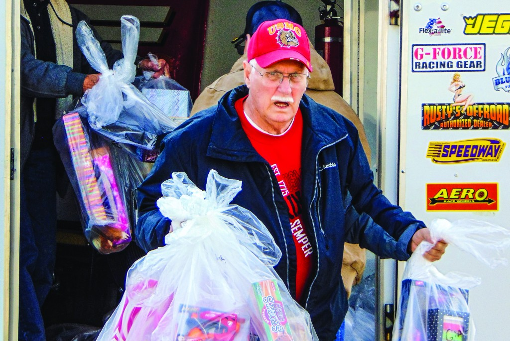 LOCAL CHARITIES find inspiration by helping others, and in turn help the twin-lakes area thrive. James Gensler was part of a contingent from the local Marine Corps League 1254 that unloaded toys at Saint Ann Parish on Friday. The items were delivered with the help of Tom Maples and Maples Ford.