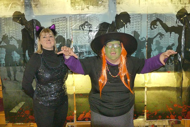 HALLOWEEN FESTIVITIES are underway throughout Warsaw that will culminate with Halloween Hoopla on Main Street October 31. The Warsaw Shrine Club held a costume party on Friday that was attended by Magali Eyckerman and Sherilyn Troxel.