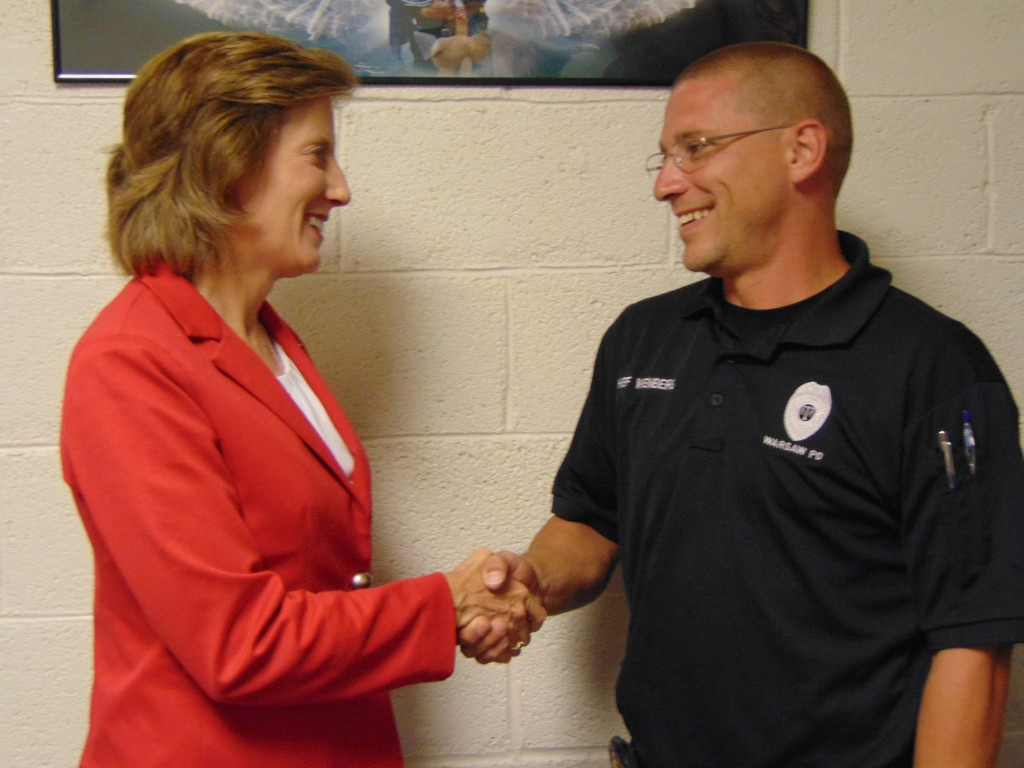 DURING A TOUR OF BENTON COUNTY on Monday, Congresswoman Vicky Hartzler met with Warsaw Police Chief Jason Wenberg. Hartzler praised Chief Wenberg for his bravery during a May gun battle resulting in the Police Chief being shot. Wenberg took down the assailant, saving the citizens of Warsaw from a potentially horrific situation.