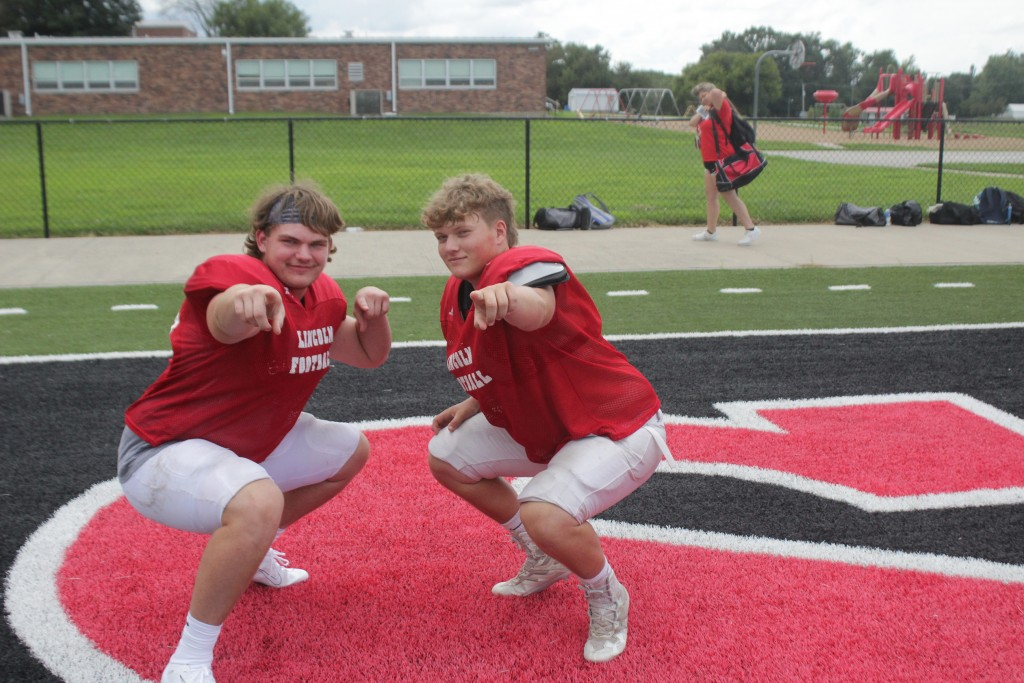 ALL-STATE LINCOLN LINEMEN TANNER BAYS AND HAYDEN BEAMAN have fun before practice on Thursday. They will be all business come this Friday night. The colleges have come calling for the kids from Lincoln.