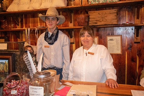 KEEPING THE PIONEER SPIRIT ALIVE, Jeremiah and Katie Johnson continued their tradition of working in the General Store at Kaysinger Bluff.