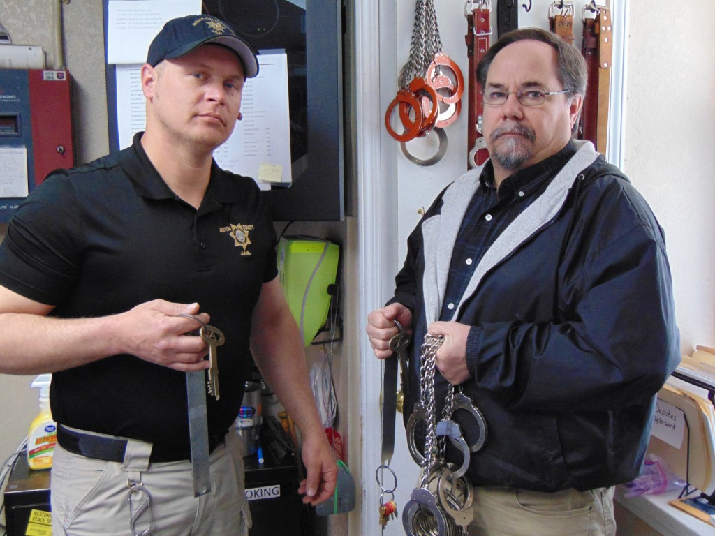 REMOVING A SET OF KEYS, Assistant Jail Administrator Nick Murphy and Benton County Jail Administrator Greg Wenberg prepared to make their rounds.  The old fashioned keys will become obsolete with the completion of the new jail which will utilize an electronic lock system.