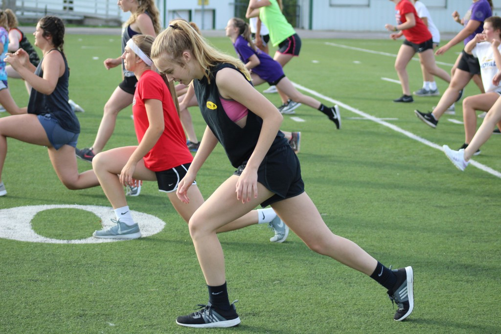 SENIOR JESSIE GLENN led some fifty girls in morning early workouts on Wednesday on the first day of voluntary practices at WHS.