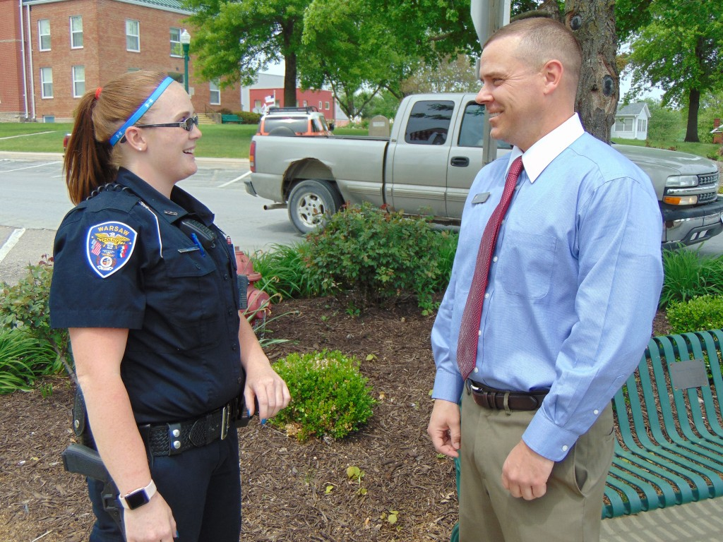 ON THE BEAT, Warsaw Police Officer Chasady Botteron greeted Josh Sater on Main Street. Botteron is only the second female Police Officer to serve on the WPD.