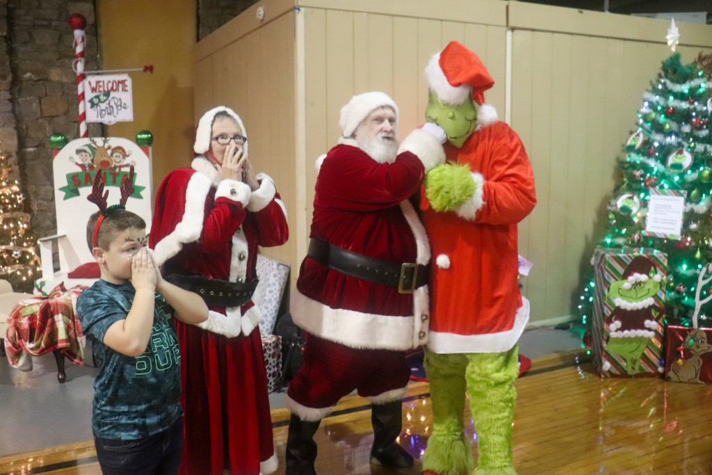 A SHOCKING SCENE unfolded at the Warsaw Community Building on Saturday when the Grinch surprised Santa, Mrs. Claus and John Hensley during the annual Breakfast with Santa program.