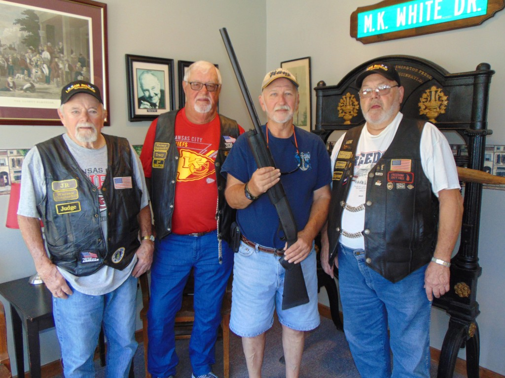 LEGION RIDERS raffled off a Remington 1187 12- Gauge   with the proceeds going to help area veterans. David Carr was the winner of the raffle and pictured (L to R) with him are JR Branic, Bill Tracy, and Jim Jones.