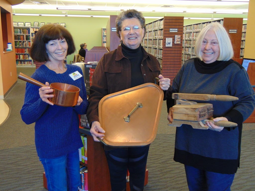 PART OF THE WARSAW LIBRARY'S rotating exhibit, Tools Of The Trade showcased cooking gadgets from around the world.  A contest for the event was hosted by Lonnie Taylor, who joined Library Director Joanne Glowczewski and winner Valerie Fauquier to mark the occasion.