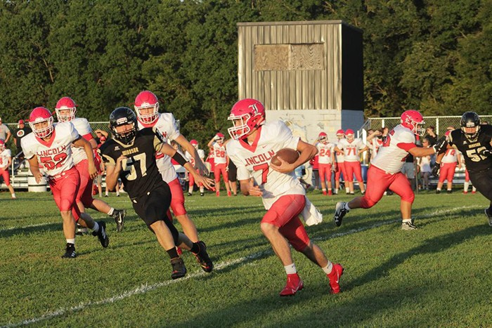 LINCOLN SOPHOMORE QUARTERBACK KYLE ECKHOFF races around the left side against Windsor in the first quarter.  Lincoln lost 41-0.