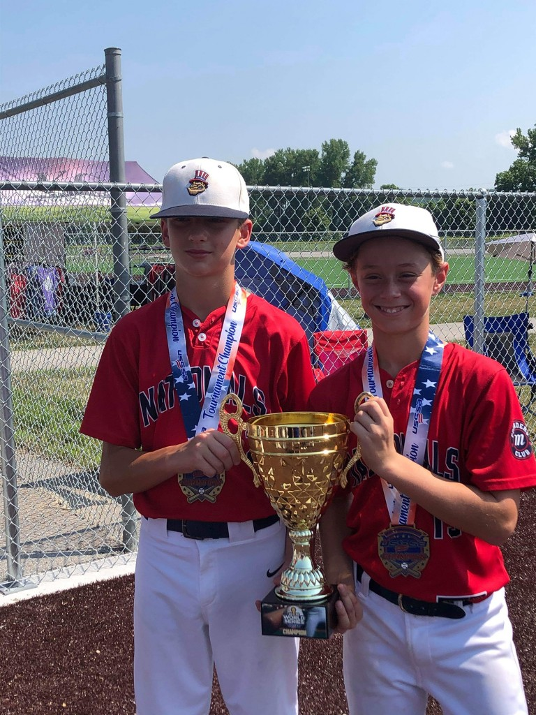 THEY ARE ON AN OUTSTANDING ROLL. After a state championship victory last week, Riley Sanders and Dawson Parrott, Lincoln, proudly hold the championship cup as they helped the Midwest Nationals win the U12 World Series over the weekend.