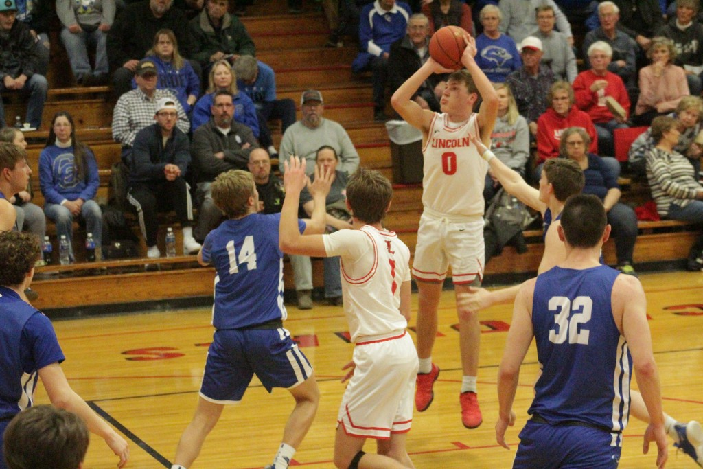 BO KROENKE SHOOTS A JUMP SHOT against Cole Camp on Friday night in Lincoln. Kroenke scored his 1000th point and had 25 points on the night in leading the Cardinals to a 68-57.