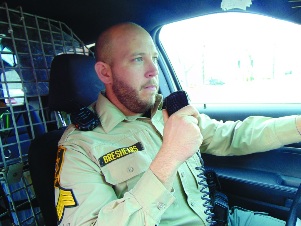 "RESPONDING TO A CALL, Benton County Sergeant Andrew Breshears stays in constant contact with a dispatcher who in a sense ""rides along.""  The Sheriff's Office has responded to over 17,000 calls this year, with many requiring an average of one hour of follow up paperwork."