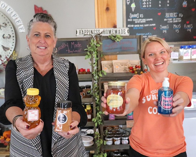 """""""BUY MISSOURI"""" was recently launched to aid retail locations selling five or more Missouri made products. Benton County Economic Development Director JoAnn Lane and Emmi Smith showed several items made here, including Jeremy Blend Seasoning, Paul's Honey, Smith Farms Salsa and Mom Cat Hand Sanitizer."""