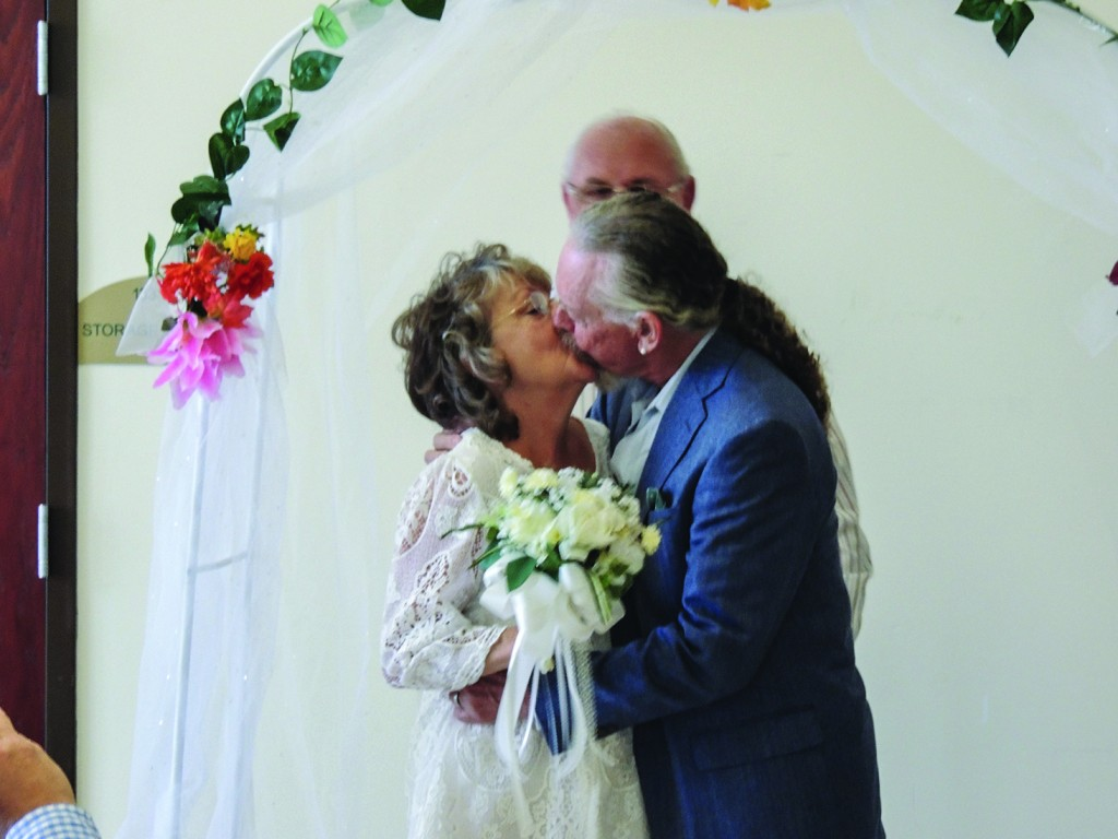 A KISS FOR THE BRIDE, Bruce Herdman And Barb West were married on Friday at the Warsaw Senior Center. The couple met at the center where they are volunteers.