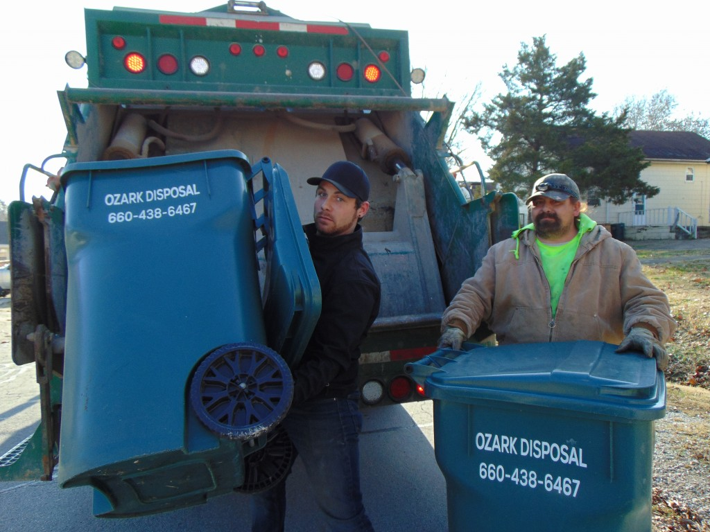 CURB SIDE COLLECTION is the beginning of a journey for much of the area's garbage. Ozark Disposal employees Jonathon Nahrstedt and Nate Macon are part of cadre of workers that help keep the Twin-Lakes area clean.