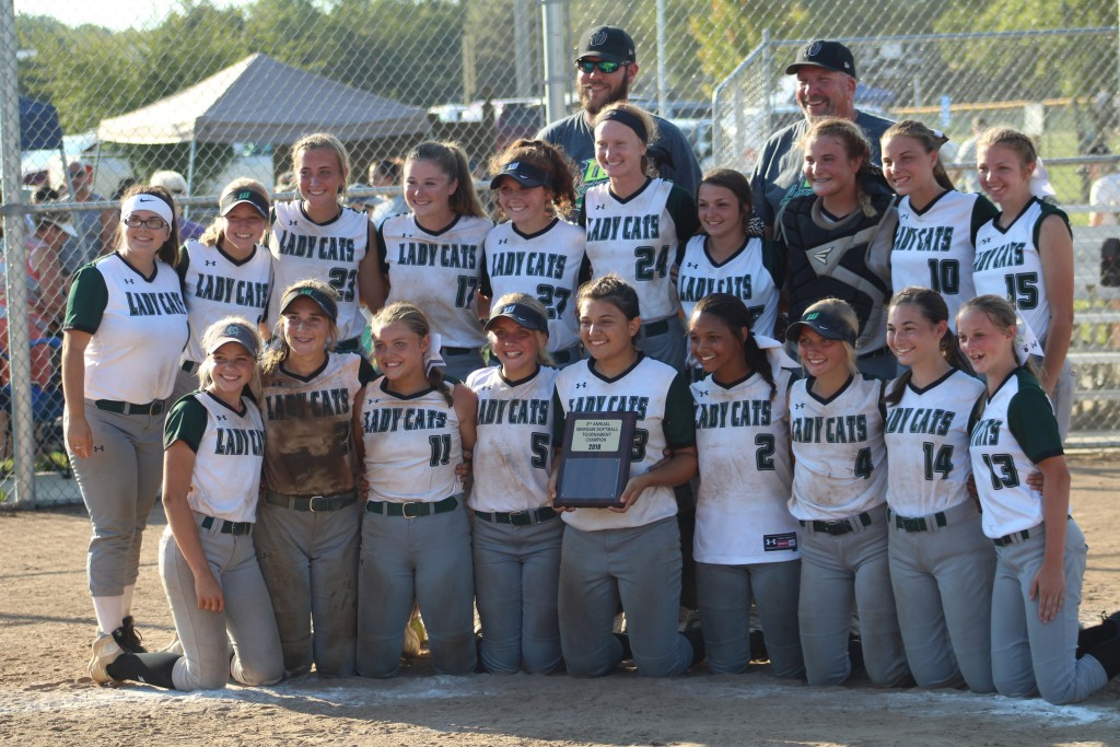 THE WARSAW LADY CATS won the Second Annual Warsaw Softball tournament on Saturday. The Lady Cats survived the blazing sun and four opponents to take the championship for the second time.
