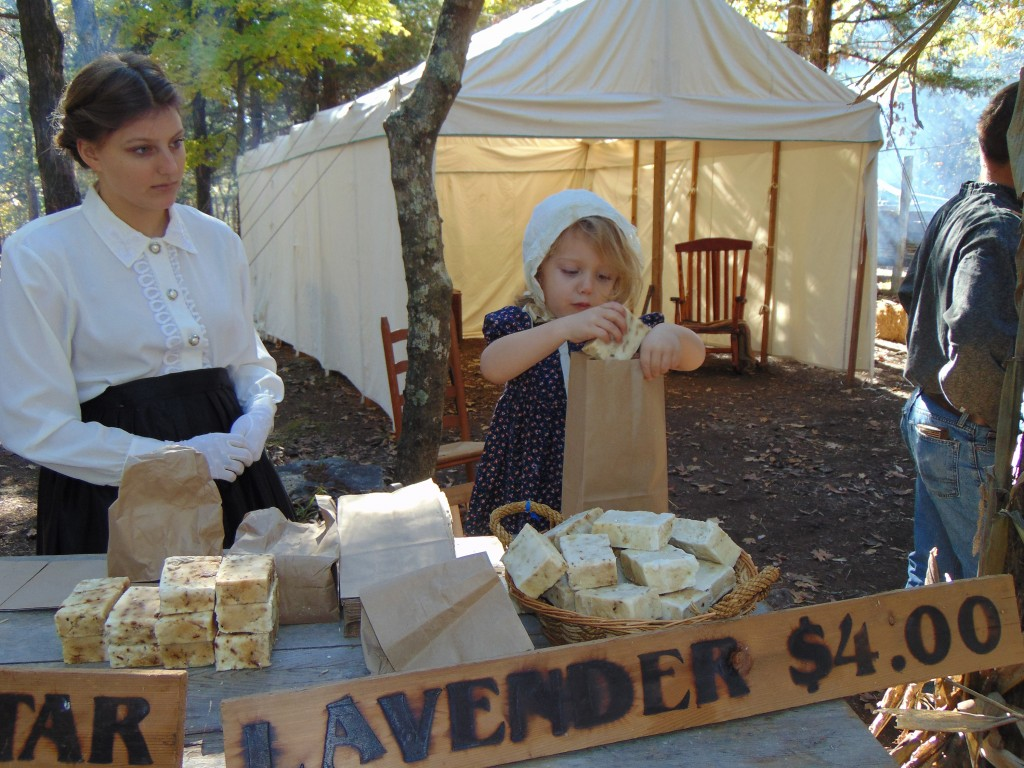 MASSIVE CROWDS AND SUNNY SKIES made the annual Heritage Days festival a hit over the weekend. Mikayla Andrews and Grace Long sold handmade soap at Kaysinger Bluff.