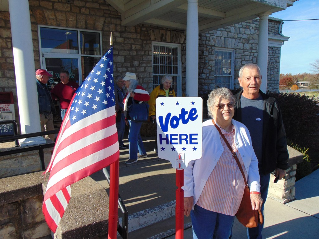 PART OF A BIG TURNOUT AT THE POLLS, Vicki and Warren Schroder cast their vote at the Warsaw Community Building on Tuesday. This year's mid-term election had several key races and amendments on the ballot.