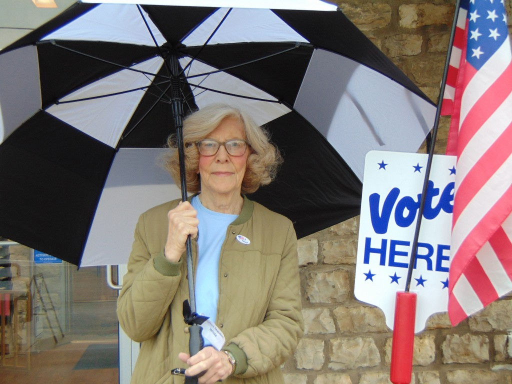 DESPITE THE RAIN, good citizens headed to the polls across Benton County on Tuesday. Sharon Karr brought her umbrella along to cast her ballot at the Warsaw Community Building.