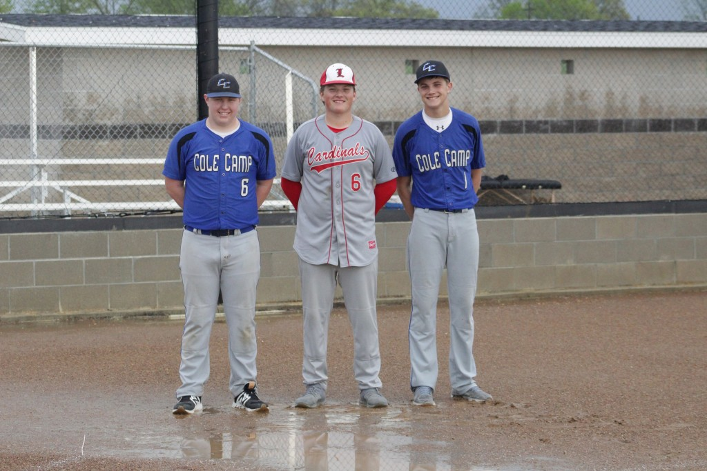 AUSTIN BUNCH OF COLE CAMP, Hayden Beaman of Lincoln and Kaden Harms of Cole Camp stand in front of a flooded home plate on Thursday in Cole Camp. The boys and girls games, playing at the same time some fifty feet apart, were rained out after around 15-20 minutes of play.