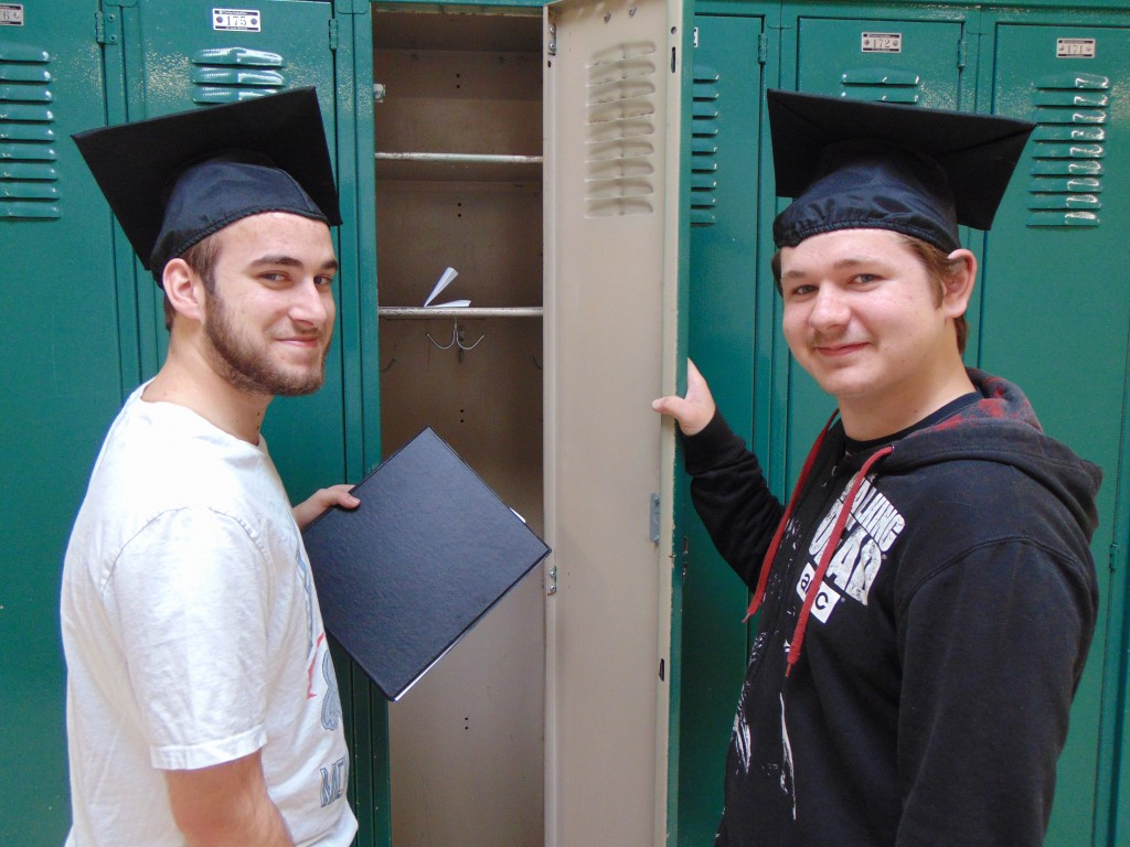 GRADUATION CEREMONIES are around the corner for Benton County schools. Eric Meldrum and Triston Good practiced wearing their graduation caps at Warsaw High School on Tuesday.