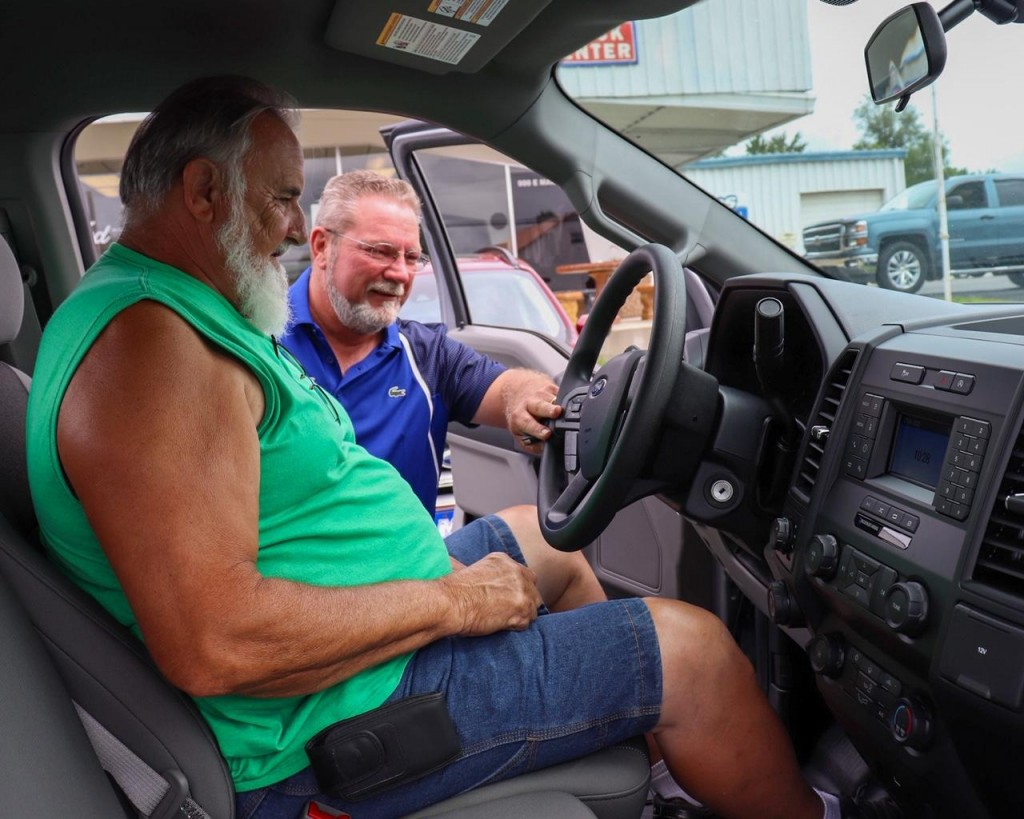 THE SUMMER SEASON has been a mixed bag for area businesses. Some establishments have seen an increase in traffic as folks stay closer to home. Chris Baker at Maples Ford in Warsaw demonstrated the features of a new truck to Raymond Ryun.  Baker said the dealership has been fortunate to have the support of its customers and community during the pandemic.
