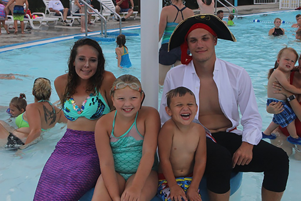 A SWASHBUCKLING GOOD TIME, mermaid Rylee Pals and pirate Cash Miller entertained Amelia Roberts and Henry Adler at the annual Warsaw Parks and Recreation Pirates and Mermaid party at the Warsaw Municipal Pool