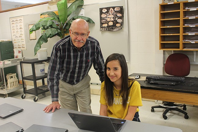 SCIENCE INSTRUCTOR David See goes over the daily plan for class with sophomore Cassidy Ferolito