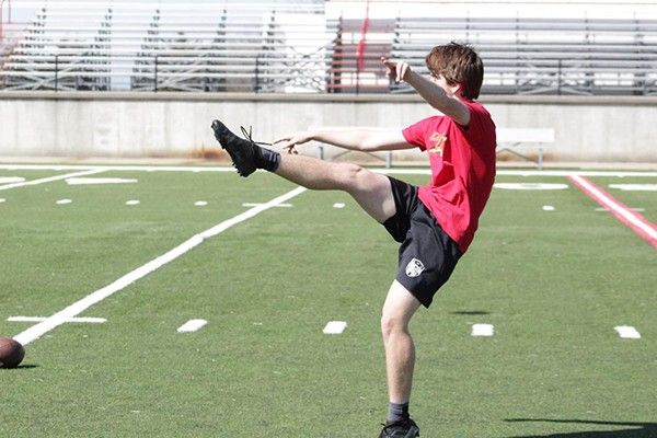 LINCOLN JUNIOR DEVON PARROTT PRACTICES kicking on Tuesday at the Lincoln football field. As a fourth grader, Parrott was told he would never play sports again because of a heart condition. He was named All-District kicker this past season on Lincoln's runner-up state championship team and was a starter on Lincoln's 14-8 varsity basketball team.