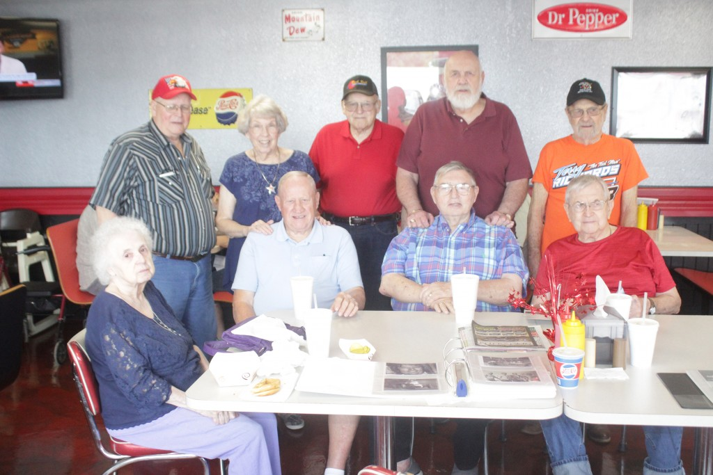 "Local Race Car Enthusiasts and Hall of Fame racers of the fifties and sixties had a reunion at Estes Drive Inn in Lincoln last week. Those in attendance sitting down were (L-R) Betty Chapman, Dale Morre, Ray Lee Goodwin and Virgil Chapman. Standing are Ed Sanders, Judy Moore, Charlie Bybee , Raymond  ""Heavy"" McNish and Terry Richards. Not pictured is Teresa Osmond."