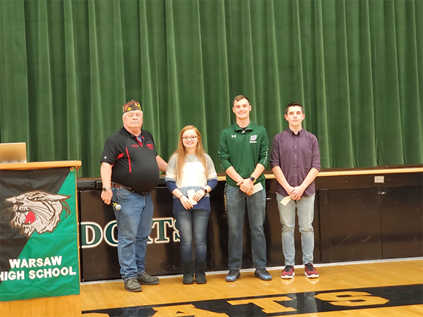 VOICE OF DEMOCRACY AWARDS ARE PRESENTED. Pictured (from L to R) Lincoln VFW Post 5925 Commander Royce Kelb, 3rd Place: Rebecca Pistesch, 2nd Place:  Matthew Couzens, 1st Place: Jonah Lindquist.