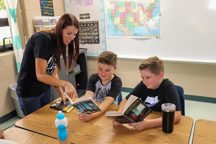 COVID-19 CLOSED AREA SCHOOLS earlier this year. Regular classes are set to resume this fall. Summer school is currently underway In Warsaw. Magan Cobb worked with Trace Callahan and Logan Gemes at North Elementary on Tuesday.