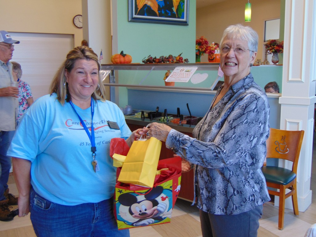 A BIG BASH took place at the Warsaw Senior Center last week to celebrate the organizations 45th anniversary. A host of activities took place including a drawing on Friday. Benton County Services Director Teresa Torrence presented Judy Masters with a first place prize.
