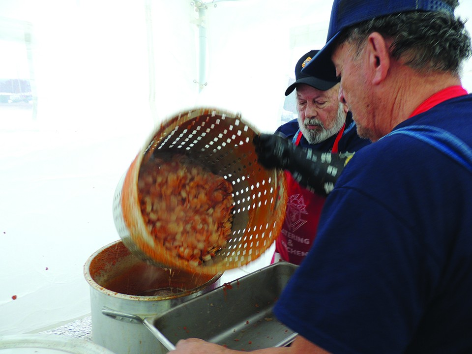 'COOKING UP A STORM,' Mike Shortino  and Steve Garcia boiled shrimp for over 600 people during Saturday's  Monster Shrimp Boil in Warsaw. The event was hosted by the Knights of Columbus with proceeds going to local charities.