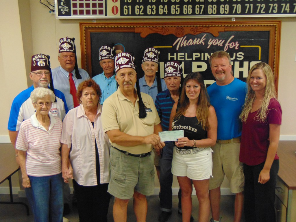 THE ANNUAL CHANNEL HOP POKER RUN sponsored by the Warsaw Shrine Club raised $1206.00. Attending the check presentation ceremony on Tuesday were front row: Gloria Curtin, Bonnie Call, David Malecki, Dianne Kolb, Jim Kolb, Jennifer Kolb. Back row: Jim Miller, Chuck Allcorn, Herb Harris, Carl Ireland and Ed Curtin.